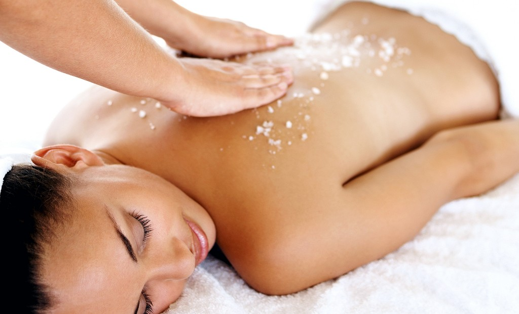 Salt treatment: Young female pampering herself