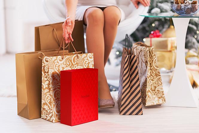 Closeup on young woman among shopping bags
